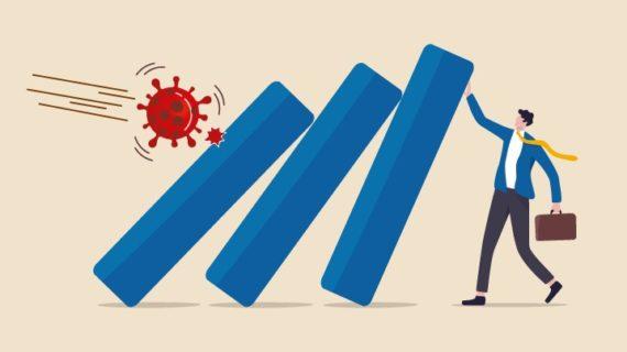 Mann in Anzug blockiert Virus
